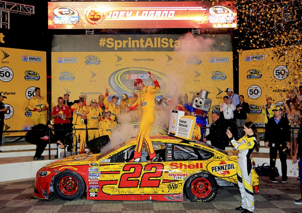 Joey Logano celebrates after winning the NASCAR Sprint Cup Series Sprint All-Star Race at Charlotte Motor Speedway on May 21, 2016 in Charlotte, North Carolina.