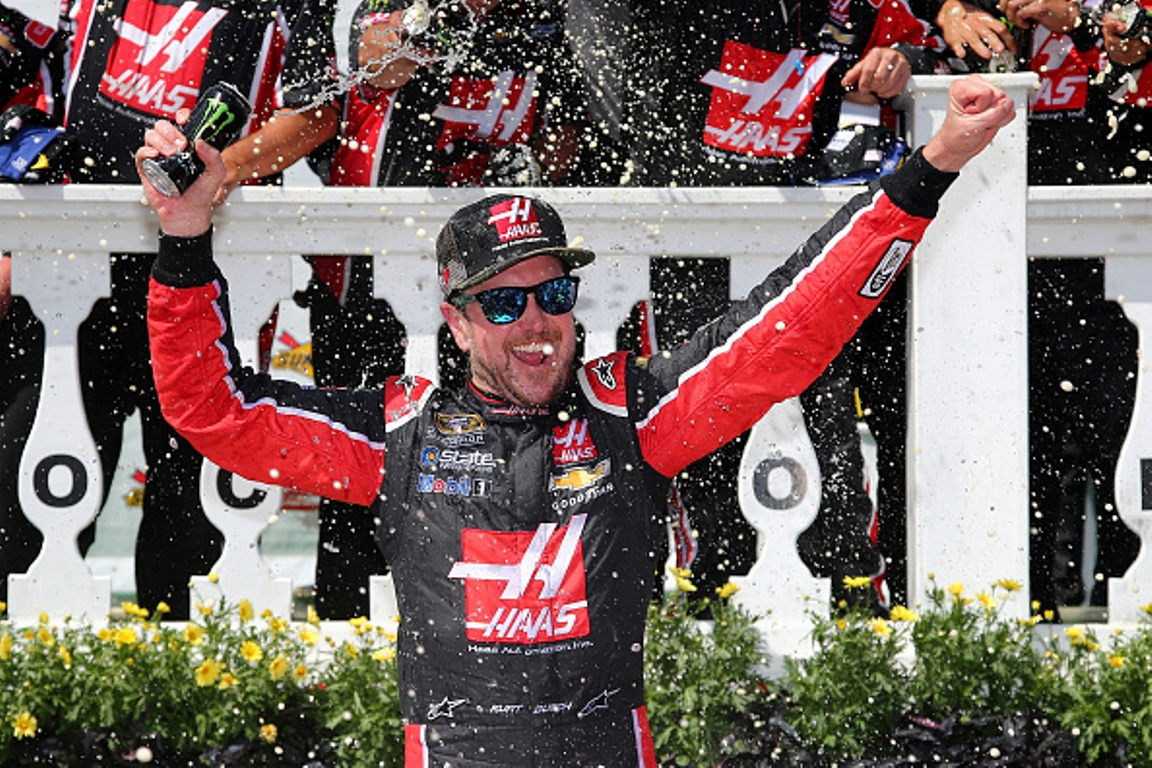 "Kurt Busch celebrates after winning the NASCAR Sprint Cup Series Axalta ""We Paint Winners"" 400 at Pocono Raceway on June 6, 2016 in Long Pond, Pennsylvania."