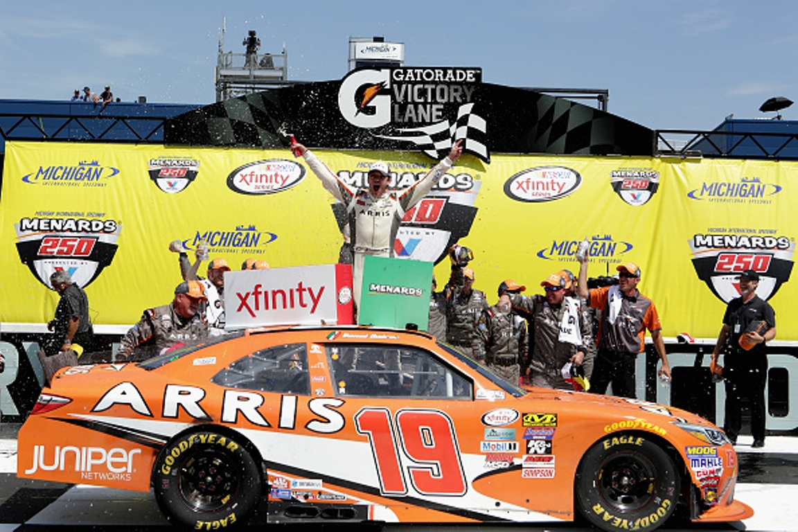 Daniel Suarez celebrates his win after the NASCAR XFINITY Series Menards 250 at Michigan International Speedway on June 11, 2016 in Brooklyn, Michigan.