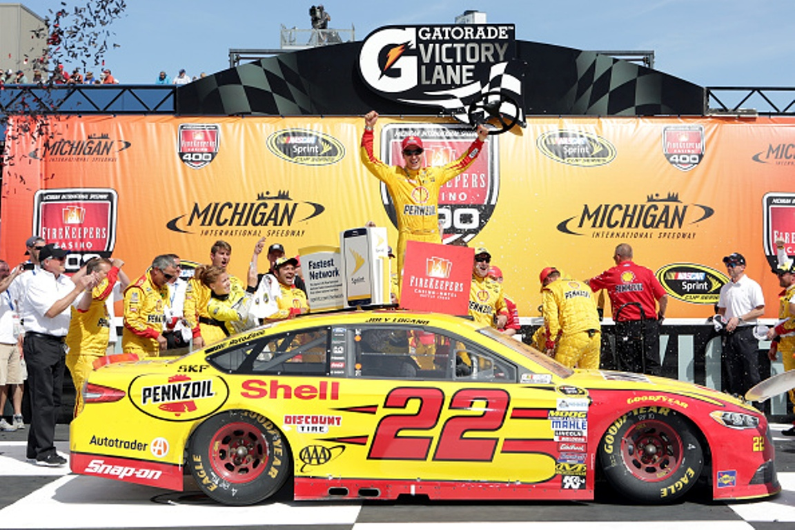 Joey Logano celebrates after winning the NASCAR Sprint Cup Series FireKeepers Casino 400 at Michigan International Speedway on June 12, 2016 in Brooklyn, Michigan.