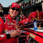 Kyle Busch, driver of the #18 Skittles Toyota, poses with the winner's decal in Victory Lane after winning the NASCAR Sprint Cup Series Crown Royal Presents the Combat Wounded Coalition 400 at Indianapolis Motor Speedway on July 24, 2016 in Indianapolis, Indiana.  (Getty Images)