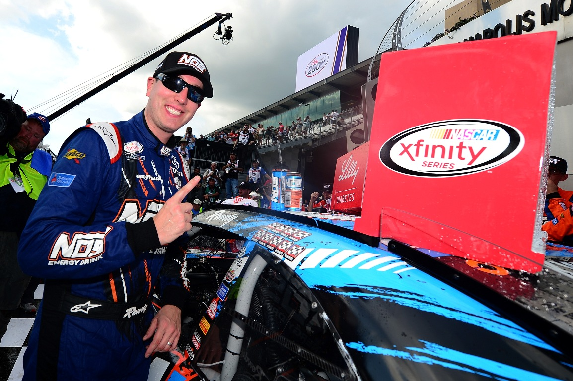 Kyle Busch, driver of the #18 NOS Energy Drink Toyota, affixes the winner's decal on his car in victory lane after winning the NASCAR XFINITY Series Lilly Diabetes 250 at Indianapolis Motor Speedway on July 23, 2016 in Indianapolis, Indiana. (Getty Images)