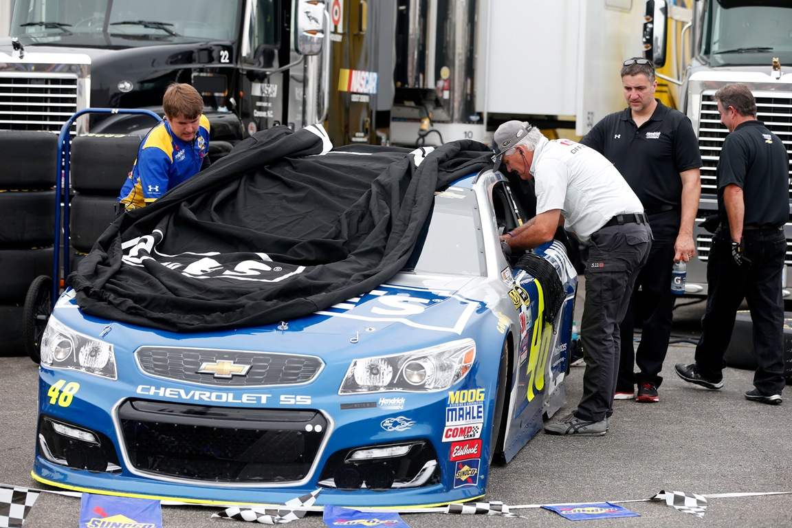 Crew members work on the car of Jimmie Johnson, driver of the #48 Lowe's Chevrolet, after an incident during practice for the NASCAR Sprint Cup Series Quaker State 400 at Kentucky Speedway on July 8, 2016 in Sparta, Kentucky. (Getty Images)