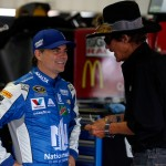 (L-R) Jeff Gordon, driver of the #88 Nationwide Chevrolet, and NASCAR Hall of Fame driver Richard Petty talk in the garage area during practice for the NASCAR Sprint Cup Series Pennsylvania 400 at Pocono Raceway on July 29, 2016 in Long Pond, Pennsylvania.