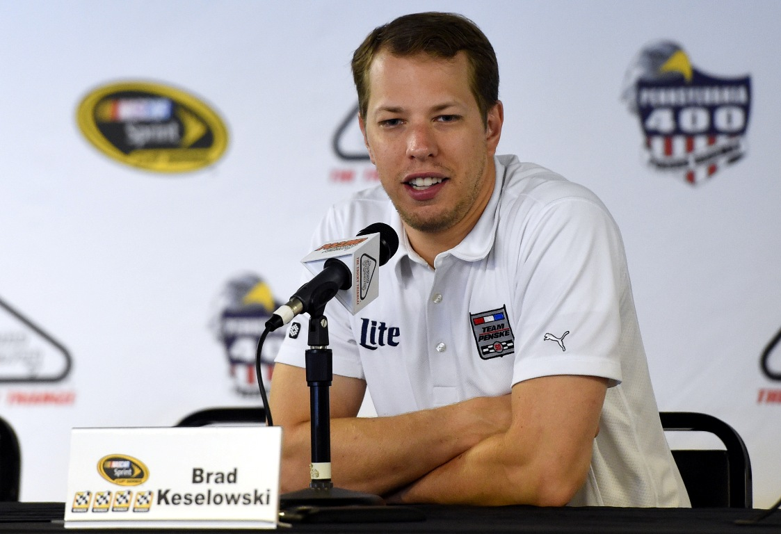 Brad Keselowski, driver of the #2 Alliance Truck Parts Ford, holds a press conference before practice for the NASCAR Sprint Cup Series Pennsylvania 400 at Pocono Raceway on July 29, 2016 in Long Pond, Pennsylvania.