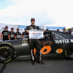 Martin Truex Jr, driver of the #78 Furniture Row Toyota, poses with the Coors Light Pole Award after qualifying for the NASCAR Sprint Cup Series Pennsylvania 400 at Pocono Raceway on July 29, 2016 in Long Pond, Pennsylvania.  (Getty Images)