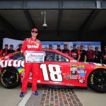 Kyle Busch, driver of the #18 Skittles Toyota, poses with the Coors Light Pole Award after qualifying for the pole position for the NASCAR Sprint Cup Series Crown Royal Presents The Combat Wounded Coalition 400 at Indianapolis Motor Speedway on July 23, 2016 in Indianapolis, Indiana.  (Getty Images)
