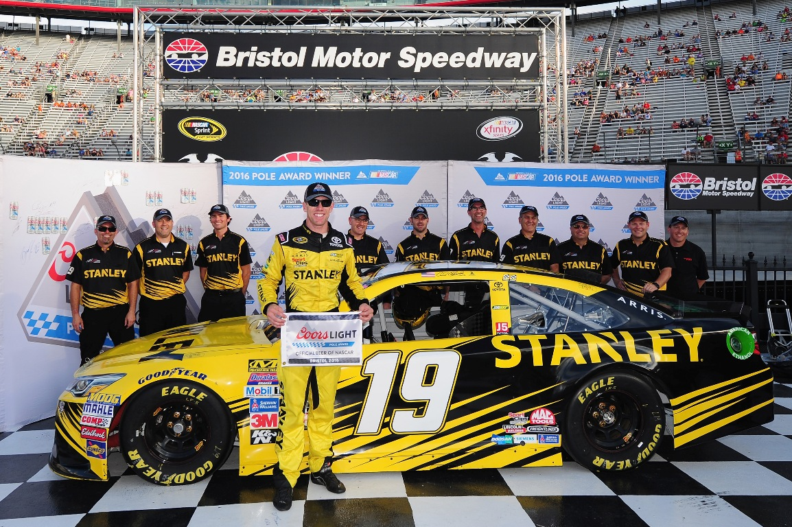 Carl Edwards celebrates his fourth season pole at Bristol Friday. (Getty Images)