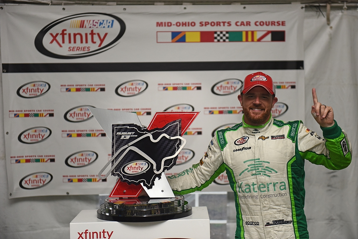 Justin Marks driver of the #42 Katerra Chevrolet celebrates in Victory Lane after taking first place in the 4th annual NASCAR XFINITY Series Mid-Ohio Challenge at Mid-Ohio Sports Car Course on August 13, 2016 in Lexington Ohio. (Getty Images)