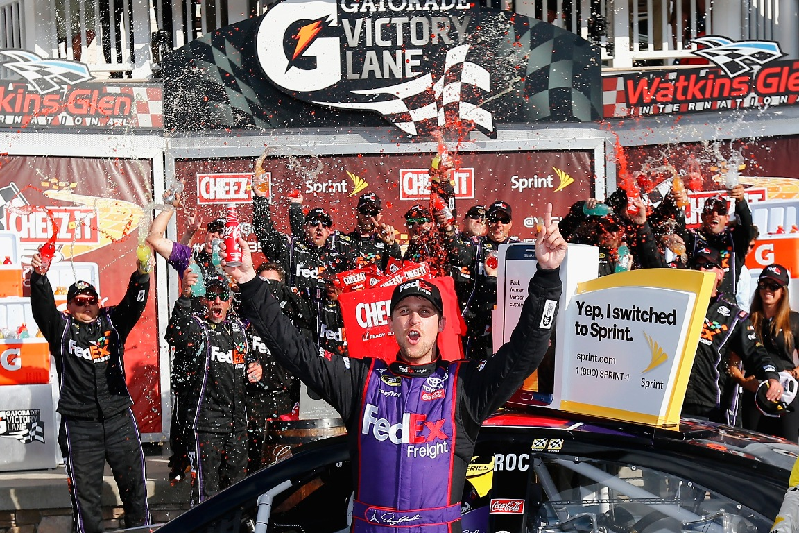 Denny Hamlin, driver of the #11 FedEx Freight Toyota, celebrates in victory lane after winning the NASCAR Sprint Cup Series Cheez-It 355 at Watkins Glen International on August 7, 2016 in Watkins Glen, New York. (Getty Images)