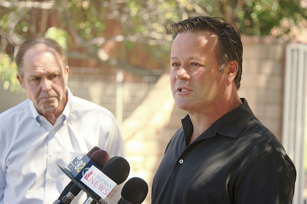 Son Robby Gordon makes a statement outside his home, next-door to his parents, Robert Gordon, 69, and his wife, Sharon, 57 in Orange Park Acres on Thursday. The couple were found dead inside their home Wednesday evening. (OCRegister)