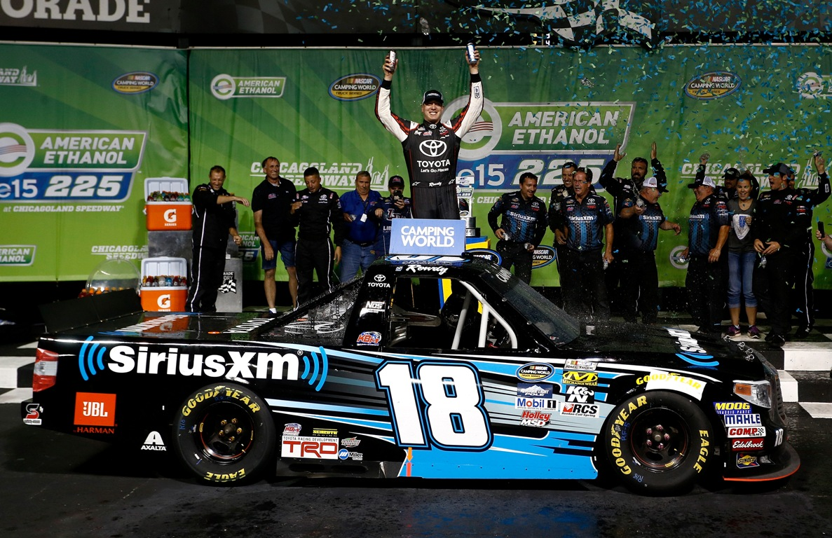 Kyle Busch, driver of the #18 SiriusXM Toyota, celebrates in Victory Lane after winning the NASCAR Camping World Truck Series American Ethanol E15 225 at Chicagoland Speedway on September 16, 2016 in Joliet, Illinois. (Getty Images)