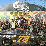 Martin Truex Jr. celebrates in victory lane at Chicagoland Sunday. (Getty Images)