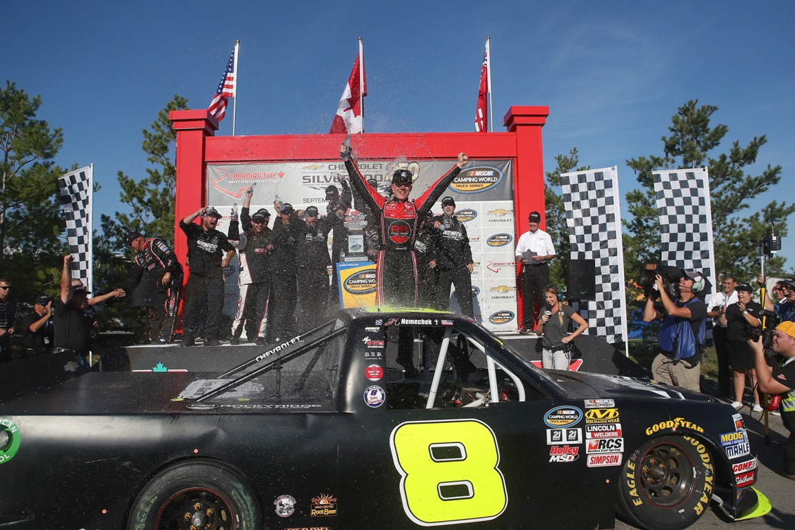John H Nemechek, driver of the #8 NEMCO Motorsports Chevrolet, celebrates his win at victory lane with his crew at Canadian Tire Motorsport Park on September 4, 2016 in Bowmanville, Canada. (Getty Images)