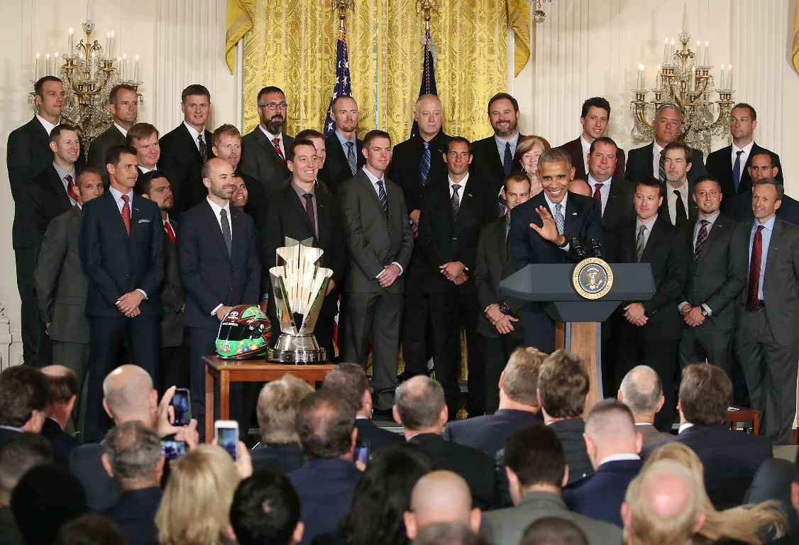 U.S. President Barack Obama speaks about Sprint Cup Champion Kyle Busch, (3rdL), while flanked by members of his racing team, during an event in the East Room at the White House, September 28, 2016 in Washington, DC. President Obama hosted the event to honor Kyle Busch, and the Joe Gibbs Racing #18 car for their 2015 NASCAR Sprint Cup Series championship. (Getty Images)