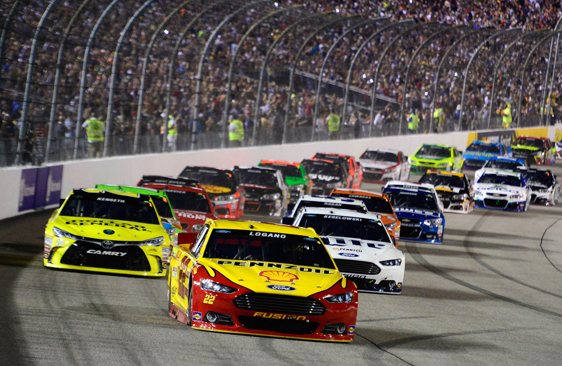 RICHMOND, VA - SEPTEMBER 12: Joey Logano, driver of the #22 Shell Pennzoil Ford, leads the field past the green flag to start the NASCAR Sprint Cup Series Federated Auto Parts 400 at Richmond International Raceway on September 12, 2015 in Richmond, Virginia. (Photo by Robert Laberge/Getty Images)