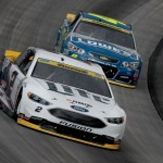 Brad Keselowski, driver of the #2 Miller Lite Ford, races Jimmie Johnson, driver of the #48 Lowe's Chevrolet, during the NASCAR Sprint Cup Series Citizen Solider 400 at Dover International Speedway on October 2, 2016 in Dover, Delaware.  (Getty Images)