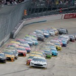 Brad Keselowski and Martin Truex Jr. lead the field to the green Sunday at Dover. (Getty Images)