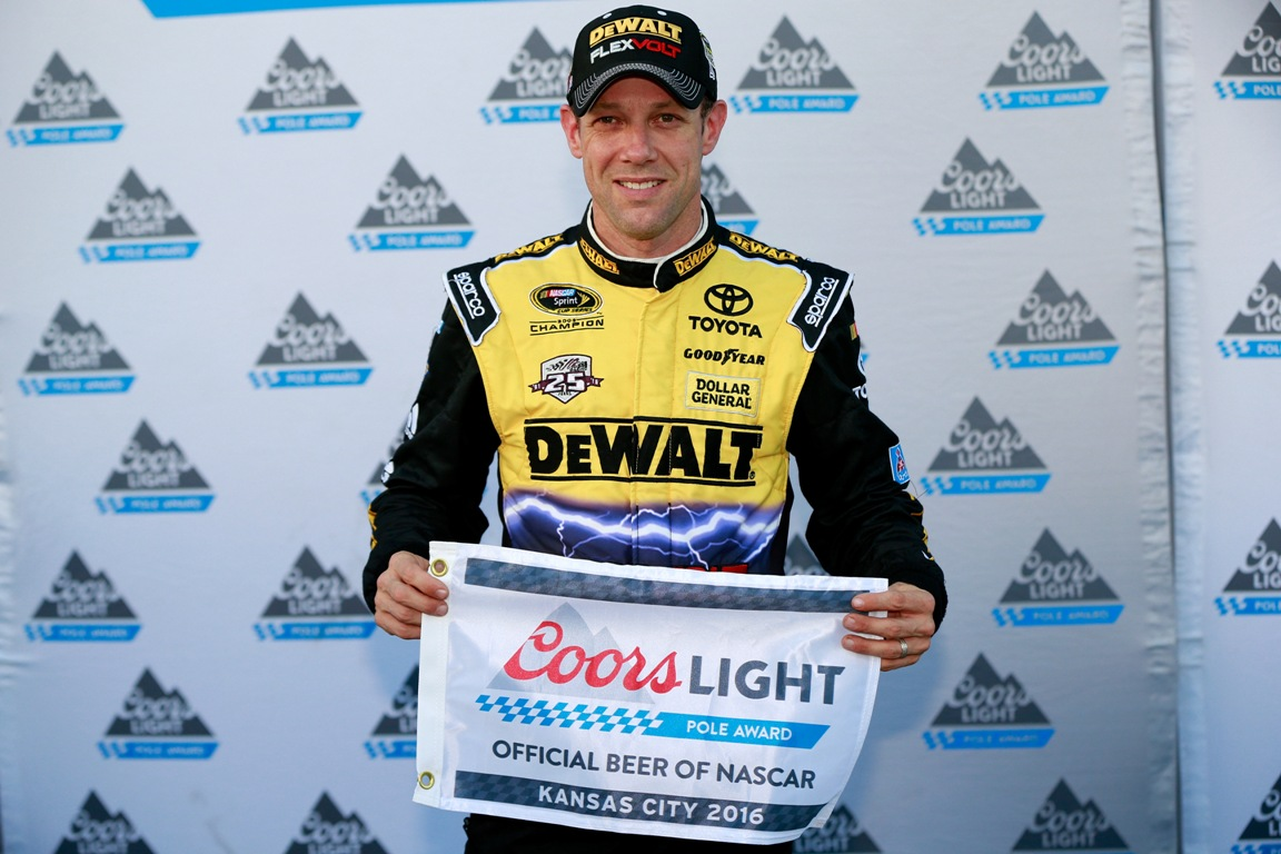 Matt Kenseth, driver of the #20 DEWALT FLEXVOLT Toyota, poses with the Coors Light Pole Award after qualifying in the pole position for the NASCAR Sprint Cup Series Hollywood Casino 400 at Kansas Speedway on October 14, 2016 in Kansas City, Kansas. (Getty Images)