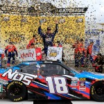 Kyle Busch celebrates his Xfinty Series win at Kansas Speedway Saturday. (Getty Images)