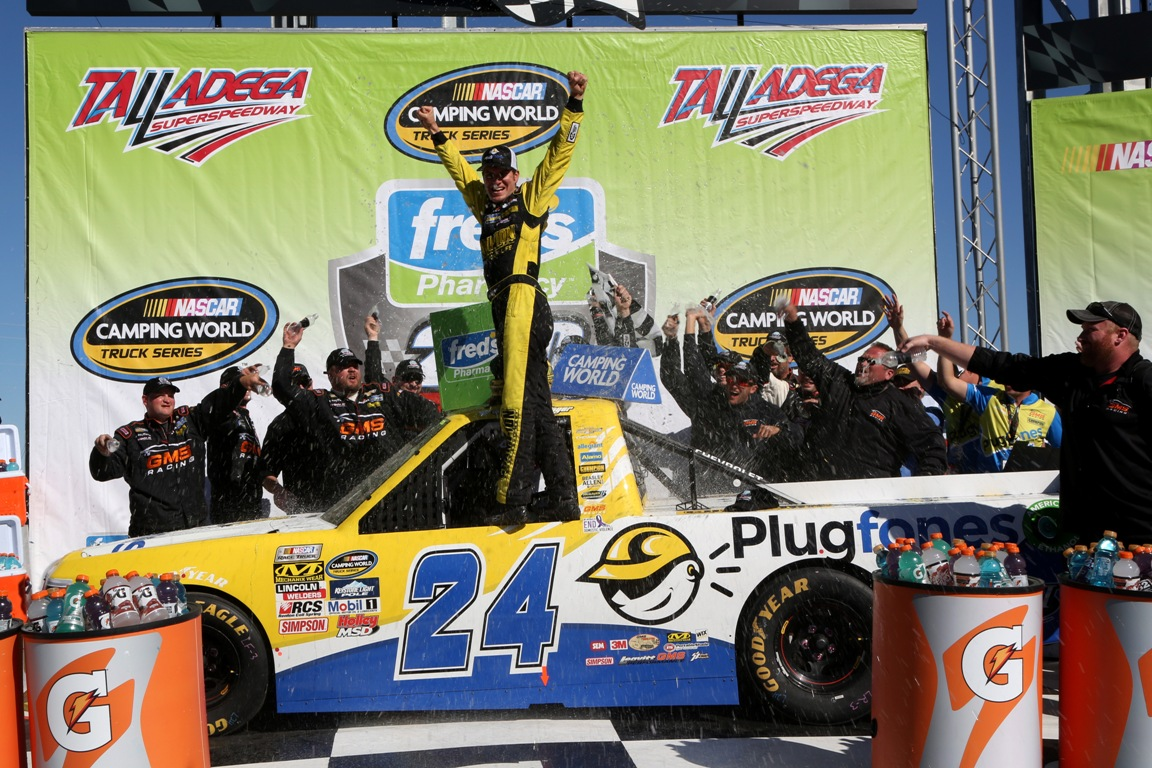 Grant Enfinger, driver of the #24 Plugfones Chevrolet, celebrates in Victory Lane after winning after the NASCAR Camping World Truck Series fred's 250 at Talladega Superspeedway on October 22, 2016 in Talladega, Alabama (Getty Images)