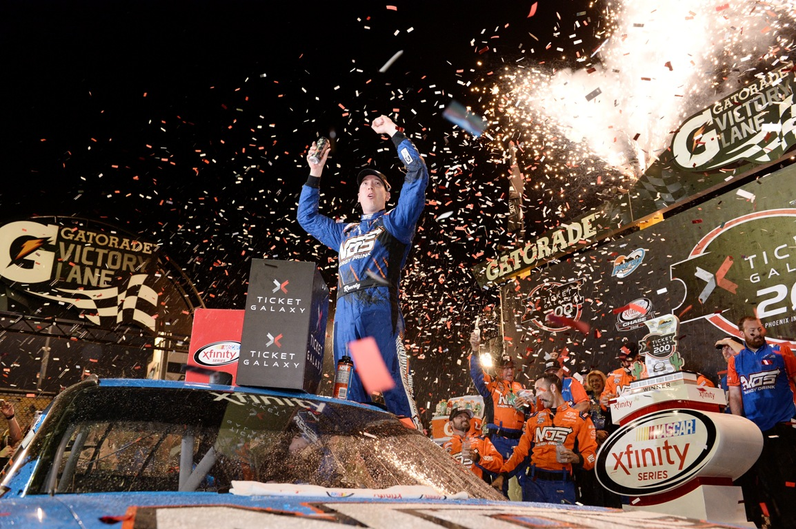Kyle Busch, driver of the #18 NOS Energy Drink Toyota, celebrates in Victory Lane after winning the NASCAR XFINITY Series Ticket Galaxy 200 at Phoenix International Raceway on November 12, 2016 in Avondale, Arizona. (Getty Images)