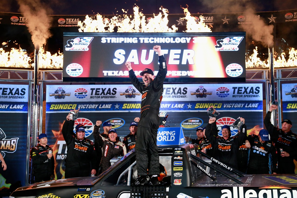 Johnny Sauter celebrates his wins at Texas Friday night. (Getty Images)