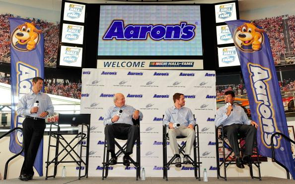 CHARLOTTE, NC - AUGUST 13:  (L-R) Michael Waltrip Racing (MWR) General Manager Ty Norris, Aaron's CEO Ronald W. Allen, driver Brian Vickers and MWR owner Michael Waltrip unveil the new 2014 No. 55 Toyota Camry Aaron's Dream Machine on August 13, 2013 at the NASCAR Hall of Fame in Charlotte, North Carolina. Aaron's and Michael Waltrip Racing announced that Vickers will pilot the car for all 36 Sprint Cup races in 2014.  (Photo by Grant Halverson/Getty Images for Michael Waltrip Racing)