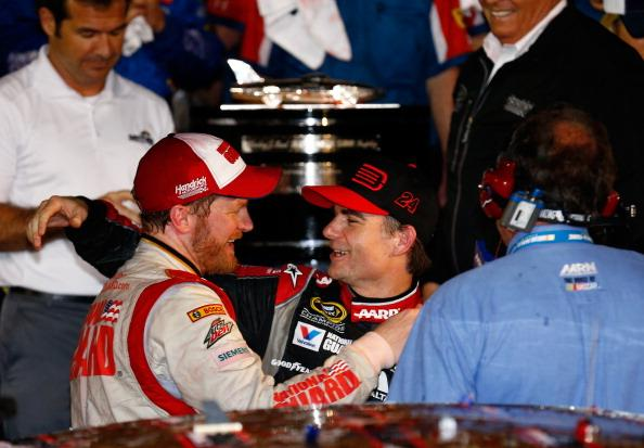 DAYTONA BEACH, FL - FEBRUARY 23:  Dale Earnhardt Jr., driver of the #88 National Guard Chevrolet, and Jeff Gordon, driver of the #24 Drive To End Hunger Chevrolet, celebrate in victory lane after winning during the NASCAR Sprint Cup Series Daytona 500 at Daytona International Speedway on February 23, 2014 in Daytona Beach, Florida.  (Photo by Tom Pennington/Getty Images)