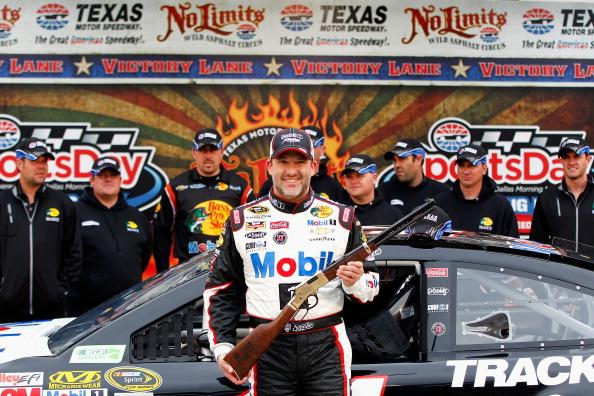 FORT WORTH, TX - APRIL 05:  Tony Stewart, driver of the #14 Bass Pro Shops / Mobil 1 Chevrolet, poses with the rifle pole award after qualifying for pole position for the NASCAR Sprint Cup Series Duck Commander 500 at Texas Motor Speedway on April 5, 2014 in Fort Worth, Texas.  (Photo by Jonathan Ferrey/Getty Images for Texas Motor Speedway)