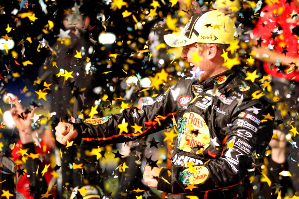 CHARLOTTE, NC - MAY 17:  Jamie McMurray, driver of the #1 Bass Pro Chevrolet, celebrates in victory lane after winning the NASCAR Sprint Cup Series Sprint All-Star Race at Charlotte Motor Speedway on May 17, 2014 in Charlotte, North Carolina.  (Photo by Sarah Glenn/Getty Images)