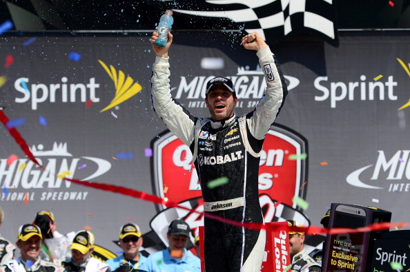 BROOKLYN, MI - JUNE 15:  Jimmie Johnson, driver of the #48 Lowe's/Kobalt Tools Chevrolet, celebrates in Victory Lane after winning the NASCAR Sprint Cup Series Quicken Loans 400 at Michigan International Speedway on June 15, 2014 in Brooklyn, Michigan.  (Photo by Patrick Smith/Getty Images)