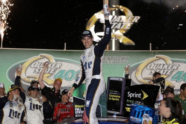 SPARTA, KY - JUNE 28:  Brad Keselowski, driver of the #2 Miller Lite Ford, celebrates in Victory Lane after winning the NASCAR Sprint Cup Series Quaker State 400 presented by Advance Auto Parts at Kentucky Speedway on June 28, 2014 in Sparta, Kentucky.  (Photo by Todd Warshaw/Getty Images)