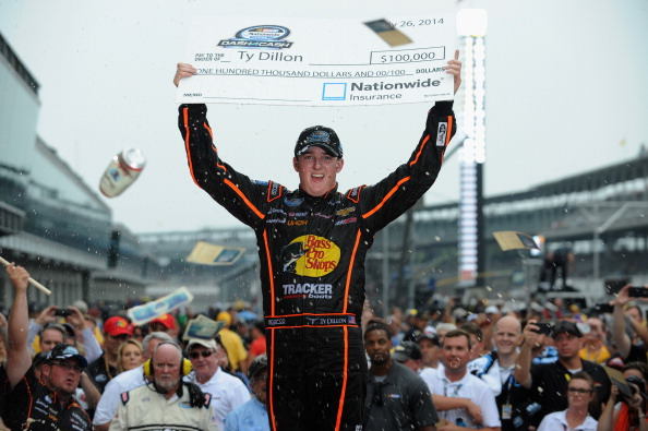INDIANAPOLIS, IN - JULY 26:  Ty Dillon, driver of the #3 Bass Pro Shops Chevrolet, celebrates winning the Nationwide Dash 4 Cash after winning the NASCAR Nationwide Series Lilly Diabetes 250 at Indianapolis Motor Speedway on July 26, 2014 in Indianapolis, Indiana.  (Photo by Rainier Ehrhardt/Getty Images)