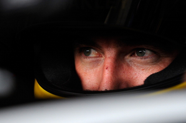 WATKINS GLEN, NY - AUGUST 08:  Marcos Ambrose, driver of the #9 Stanley Ford, sits in his car in the garage area during practice for the NASCAR Sprint Cup Series Cheez-It 355 at Watkins Glen International on August 8, 2014 in Watkins Glen, New York.  (Photo by Jared C. Tilton/Getty Images)