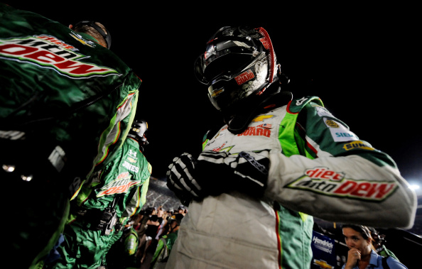 Dale Earnhardt Jr. climbs from his car during the NASCAR Sprint Cup Series Irwin Tools Night Race at Bristol Motor Speedway on August 23, 2014 in Bristol, Tennessee. (Getty Images)