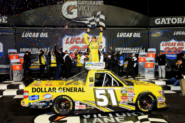 JOLIET, IL - SEPTEMBER 13:  Kyle Busch, driver of the #51 Dollar General Toyota, celebrates in Victory Lane after winning the NASCAR Camping World Truck Series Lucas Oil 225 at Chicagoland Speedway on September 13, 2014 in Joliet, Illinois.  (Photo by Daniel Shirey/Getty Images)