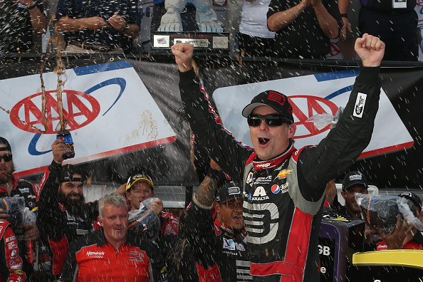DOVER, DE - SEPTEMBER 28:  Jeff Gordon, driver of the #24 Drive To End Hunger Chevrolet, celebrates in Victory Lane after winning the NASCAR Sprint Cup Series AAA 400 at Dover International Speedway on September 28, 2014 in Dover, Delaware.  (Photo by Nick Laham/Getty Images)