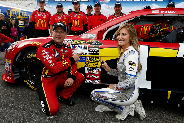 MARTINSVILLE, VA - OCTOBER 24:  Jamie McMurray, driver of the #1 McDonald's Chevrolet, poses with Miss Coors Light Rachel Rupert and the Coors Light Pole Award after qualiyfing for the pole for the NASCAR Sprint Cup Series Goody's Headache Relief Shot 500 at Martinsville Speedway on October 24, 2014 in Martinsville, Virginia.  (Photo by Jeff Zelevansky/Getty Images)