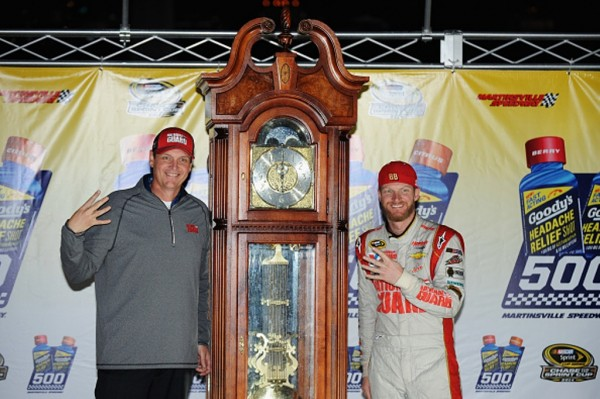 MARTINSVILLE, VA - OCTOBER 26: Dale Earnhardt Jr., driver of the #88 National Guard Chevrolet, right, and crew chief Steve Letarte pose with the trophy in Victory Lane after winning during the NASCAR Sprint Cup Series Goody's Headache Relief Shot 500 at Martinsville Speedway on October 26, 2014 in Martinsville, Virginia. (Photo by Jonathan Moore/Getty Images)
