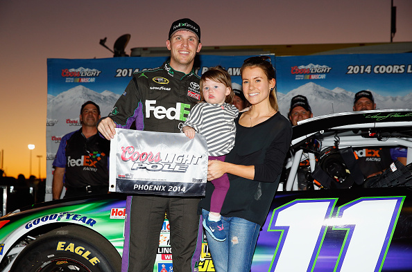 AVONDALE, AZ - NOVEMBER 07:  Denny Hamlin, driver of the #11 FedEx Ground Toyota, his girlfriend, Jordan Fish, and his daughter, Taylor James Hamlin, pose with the Coors Light Pole Award after qualifying for the pole position for the NASCAR Sprint Cup Series Quicken Loans Race for Heroes 500 at Phoenix International Raceway on November 7, 2014 in Avondale, Arizona.  (Photo by Tom Pennington/Getty Images)