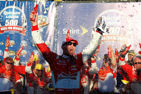 AVONDALE, AZ - NOVEMBER 09:  Kevin Harvick, driver of the #4 Budweiser Chevrolet, celebrates in victory lane after winning the NASCAR Sprint Cup Series Quicken Loans Race for Heroes 500 at Phoenix International Raceway on November 9, 2014 in Avondale, Arizona.  (Photo by Tom Pennington/Getty Images)