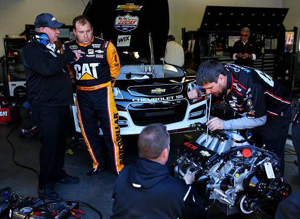 DAYTONA BEACH, FL - FEBRUARY 14:  Ryan Newman, driver of the #31 Caterpillar Chevrolet, works on his engine with crew members in the garage area during practice for the 57th Annual Daytona 500 at Daytona International Speedway on February 14, 2015 in Daytona Beach, Florida.  (Photo by Maddie Meyer/Getty Images)