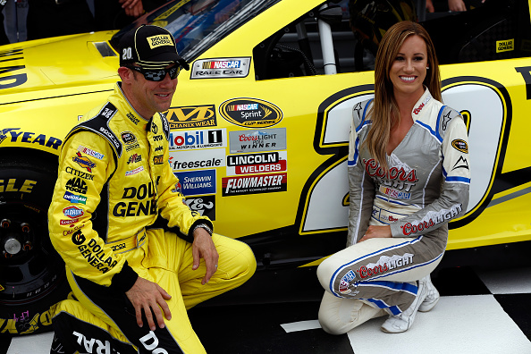 BRISTOL, TN - APRIL 17:  Matt Kenseth, driver of the #20 Dollar General Toyota, and Miss Coors Light, Rachel Rupert, pose with the Coors Light Pole Award sticker to his car after qualifying for the pole position for the NASCAR Sprint Cup Series Food City 500 at Bristol Motor Speedway on April 17, 2015 in Bristol, Tennessee.  (Photo by Jeff Zelevansky/Getty Images)