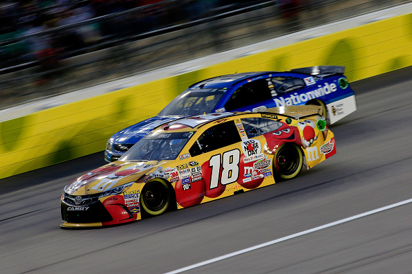 KANSAS CITY, KS - MAY 09: Erik Jones, driver of the #18 M&M's Red Nose Day Toyota, leads Dale Earnhardt Jr., driver of the #88 Nationwide Chevrolet, during the NASCAR Sprint Cup Series SpongeBob SquarePants 400 at Kansas Speedway on May 9, 2015 in Kansas City, Kansas.  (Photo by Jamie Squire/Getty Images)