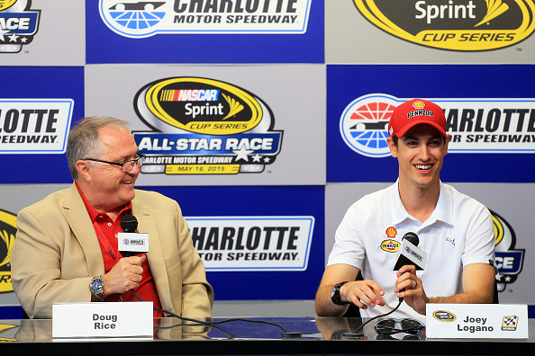 CHARLOTTE, NC - MAY 15:  Doug Rice, a broadcaster for PRN, and Joey Logano, driver for the #22 Shell Penzoil Ford, speak to the media during a press conference prior to practice for the NASCAR Sprint Cup Series All-Star Race at Charlotte Motor Speedway on May 15, 2015 in Charlotte, North Carolina.  (Photo by Daniel Shirey/Getty Images)