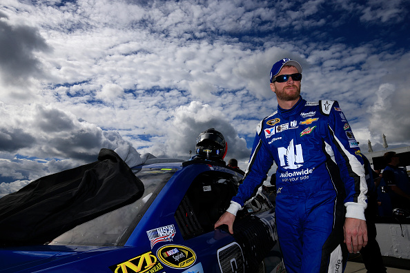"LONG POND, PA - JUNE 05:  Dale Earnhardt Jr., driver of the #88 Nationwide Chevrolet, stands on the grid during qualifying for the NASCAR Sprint Cup Series Axalta ""We Paint Winners"" 400 at Pocono Raceway on June 5, 2015 in Long Pond, Pennsylvania.  (Photo by Chris Trotman/Getty Images)"