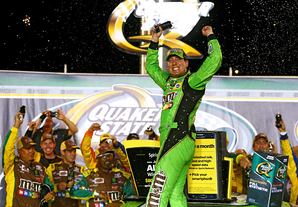 SPARTA, KY - JULY 11:  Kyle Busch, driver of the #18 M&M's Crispy Toyota, celebrates in Victory Lane after winning the NASCAR Sprint Cup Series Quaker State 400 presented by Advance Auto Parts at Kentucky Speedway on July 11, 2015 in Sparta, Kentucky.  (Photo by Sarah Crabill/Getty Images)