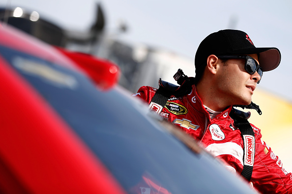 481132940-kyle-larson-driver-of-the-target-chevrolet-stands-on