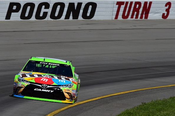 LONG POND, PA - JULY 31: Kyle Busch, driver of the #18 M&M's Crispy Toyota, practices for the NASCAR Sprint Cup Series Windows 10 400 at Pocono Raceway on July 31, 2015 in Long Pond, Pennsylvania. (Photo by Jared C. Tilton/Getty Images)